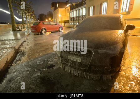 Frozen vehicle on the shore of Lake Geneva, during the bisexual episode of 17 January 2017, Versoix, Switzerland - Stock Photo
