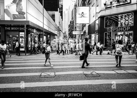 People walking on Queen's Road, Central after work - Stock Photo