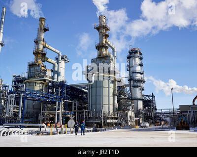Tradesmen Working At A Refinery; Edmonton, Alberta, Canada - Stock Photo