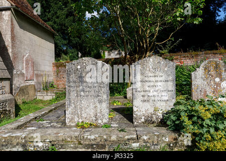 Gravestones of Jane Austen's mother and sister Cassandra in churchyard of the parish church of St Nicholas, Chawton, - Stock Photo