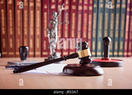Court Judge's gavel, Themis - the goddess of justice, notary public stamper and law codes in the background. Law - Stock Photo