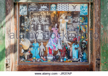 United States, Louisiana, New Orleans, French Quarter. Voodoo dolls for sale in the window of a shop. - Stock Photo