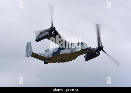 Bell Boeing V-22A Osprey 11-0061 of the US Air Force flying at an airshow. Space for copy. The Osprey is a tiltrotor - Stock Photo