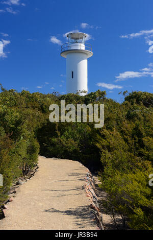 Cape Tourville Lighthouse in Freycinet National Park on East Coast of Tasmania, Australia - Stock Photo