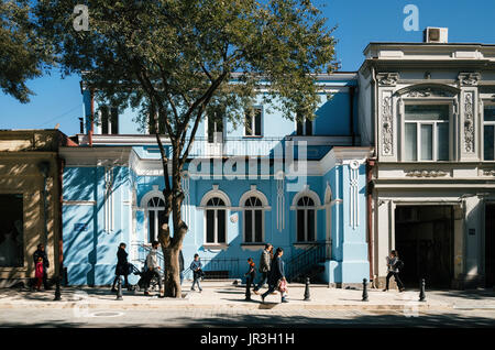 Tbilisi, Georgia - October 15, 2016: Architecture of Tbilisi centre on the background of People going by the tourist - Stock Photo