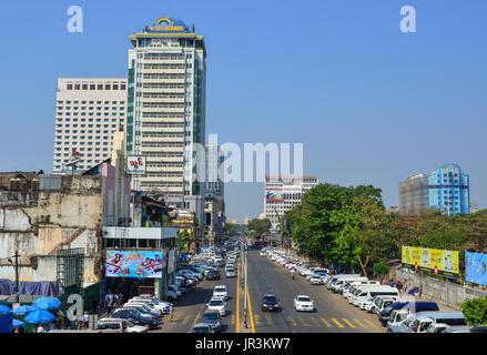 Yangon, Myanmar - Feb 13, 2017. Traffic on main street at downtown in Yangon, Myanmar. Yangon is Myanmar largest - Stock Photo