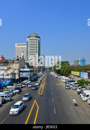 Yangon, Myanmar - Feb 13, 2017. Cars running on street at downtown in Yangon, Myanmar. Yangon is Myanmar largest - Stock Photo