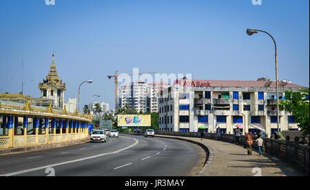 Yangon, Myanmar - Feb 13, 2017. Traffic on street at downtown in Yangon, Myanmar. Yangon is Myanmar largest city - Stock Photo