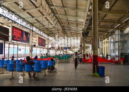 Yangon, Myanmar - Feb 13, 2017. People at waiting room of the Central Railway Station in Yangon, Myanmar. Yangon - Stock Photo