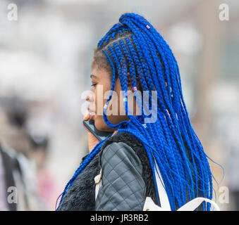 Young black woman with braided blue hair. - Stock Photo