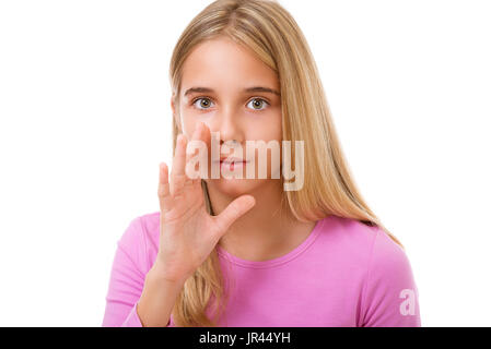 Picture of young girl whispering gossip over white background - Stock Photo
