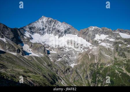 Trekking in the Zillertal seen here with the Grosser Loeffler mountain from the Kasseler Hut mountain refuge. - Stock Photo