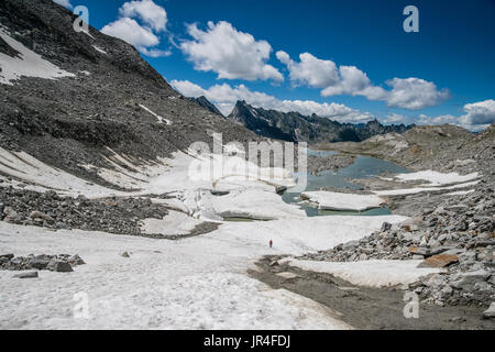 Trekking in the Zillertal seen here with mountaineers on ice remnants of the Stillupp Kees glacier - Stock Photo