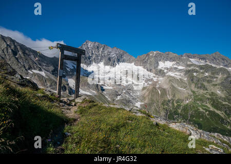 Trekking in the Zillertal seen here with the portal doorway near the Kasseler Hut mountain refuge - Stock Photo