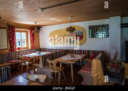Trekking in the Zillertal seen here with the interior of the Greizer Hut mountain refuge - Stock Photo