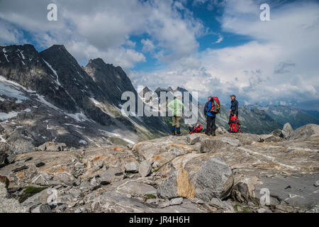 Trekking in the Zillertal seen here with mountaineers near the Greizer Hut mountain refuge - Stock Photo