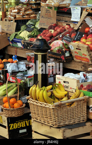 fresh fruit and vegetables dislayed enticingly in the front of a shop on the street in a very colourful way - Stock Photo