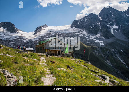 Trekking in the Zillertal seen here with the Greizer Hut mountain refuge - Stock Photo
