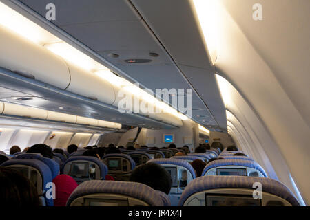 Aircraft Airbus A330-300 of China Airlines (national carrier of Taiwan) CI-917 cabin interior view, economy class, fly from Taiwan to Hong Kong, Asia