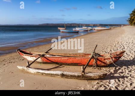 A traditional fishing boat beached on Ramena beach of Antsiranana bay (Diego Suarez), north of Madagascar - Stock Photo