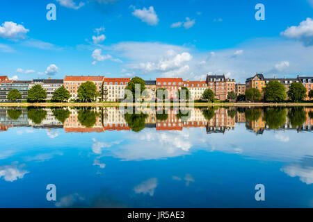 Houses along river in Downtown District of Copenhagen Denmark - Stock Photo