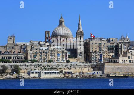 View of the Valletta skyline, from Sliema, across the Marsamxett harbour, in Malta - Stock Photo