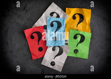 Crumpled colorful paper notes with question marks. Close up. - Stock Photo
