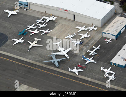 aerial view of private jets outside Clay Lacy Aviation hangar, Boeing Field, Seattle, Washington State, USA - Stock Photo