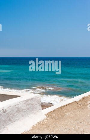Blue beach, white wall - Stock Photo