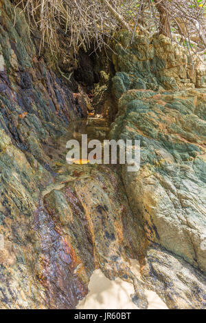 Small clean water lake between rocks by the beach - Stock Photo