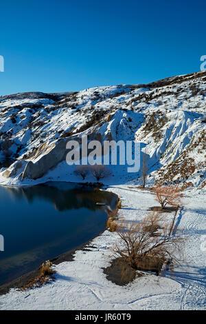 Snow around Blue Lake, St Bathans, Maniototo, Central Otago, South Island, New Zealand - Stock Photo