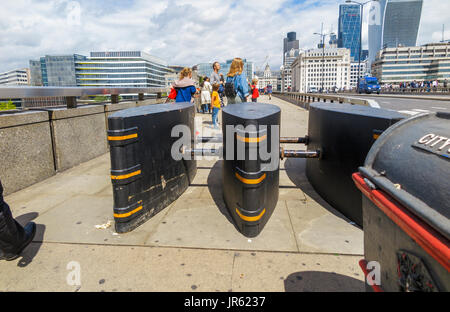 Anti-vehicle barriers erected on the pavement on London Bridge in the Borough area, Southwark, London SE1 as a terrorism - Stock Photo