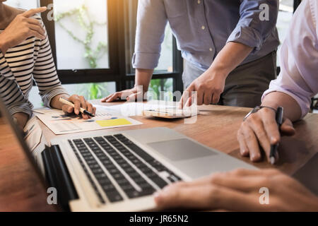 Creative Team job. young business man working with startup project analyse graph plans and discuss at  workspace - Stock Photo