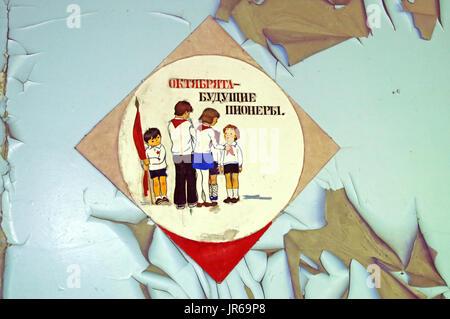 CHORNOBYL, UKRAINE -JULY 15, 2007: Old communist poster in abandoned building in school in Chernobyl Zone. Chornobyl - Stock Photo