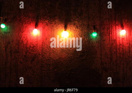 Multi-colored lights hanging on a wall - Stock Photo