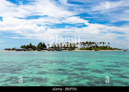 Beautiful clear and turquoise colored water near Maiga Island located in Semporna in the vicinity of Sipidan Island - Stock Photo