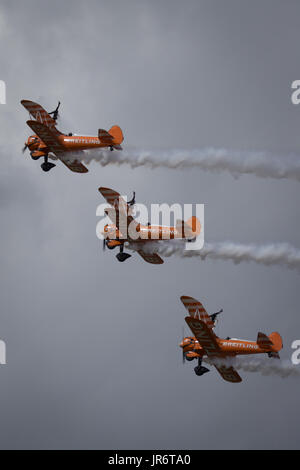 Fairford, Gloucestershire, UK - July 10th, 2016: AeroSuperBatics Breitling Stearman Wing Walking Formation Display - Stock Photo