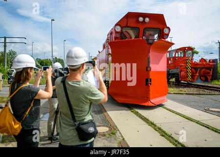 Berlin, Germany. 4th Aug, 2017. Journalists taking pictures of a 'Meiningen W'-type snowplow in Berlin, Germany, - Stock Photo