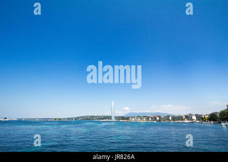 Geneva's main monument and landmark, the Jet d'Eau (Water Jet), taken in a summer afternoon with a blue sky. Geneva - Stock Photo