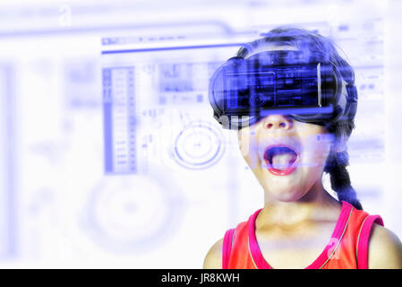 Young child wearing a virtual reality VR headset enjoys various high technology HUD digital effect displays - Stock Photo