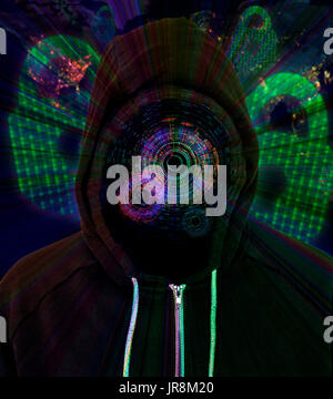 Computer hacker wearing a hooded black top with an augmentation HUD Display with padlocks and binary code in the - Stock Photo