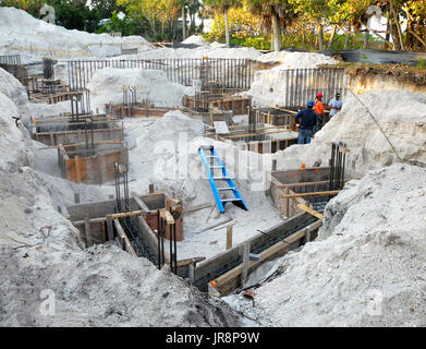 Deep excavation with buried steel rebar rods and box forms to be filled with reinforced concete were required to - Stock Photo