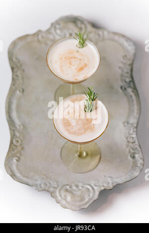 Two Creamy Cocktails on a vintage tray - Stock Photo