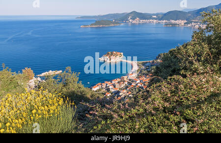 Panorama of Sveti Stefan island in a beautiful summer morning in Budva, Montenegro. - Stock Photo