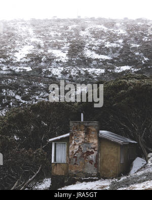 Abandoned house on the way up to Mount Hotham covered in snow. - Stock Photo