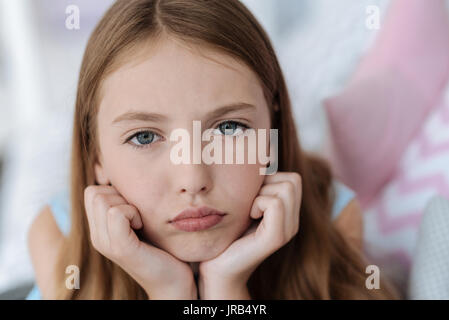 Sad young lady looking into the camera - Stock Photo