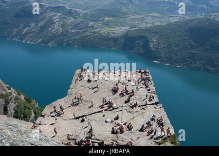 One of the most popular attractions in Norway is a Preikestolen - Pulpit Rock - cliff hanging high above Lysefjorden. - Stock Photo