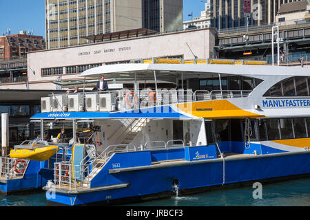 Manly fast ferry at Circular quay in front of the railway station,Sydney,Australia - Stock Photo