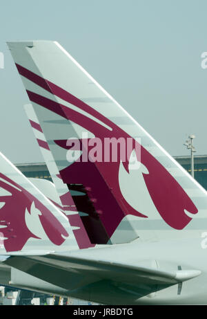 Tails of Boeing 777 of Qatar Airways in Hamad International Airport - Stock Photo