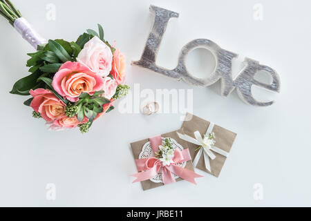 Top View Of Golden Wedding Rings Decorative Envelopes Beautiful Bouquet And Love Symbol